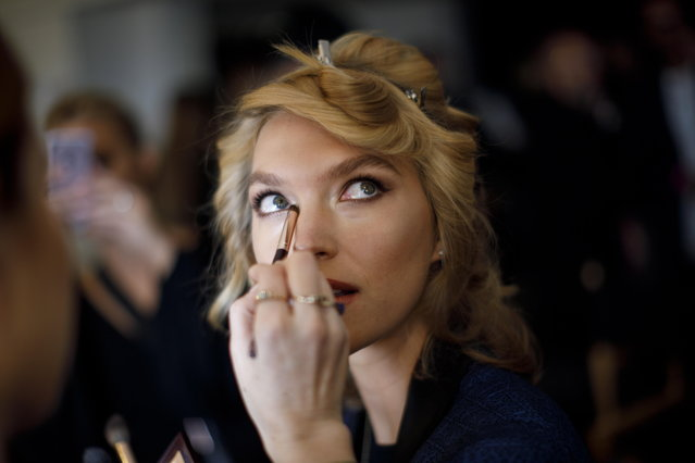 US model Arizona Muse has her hair and make-up done backstage ahead of a show by Temperley London at the London Fashion Week, in London, Britain, 15 September 2018. (Photo by Tolga Akmen/EPA/EFE)