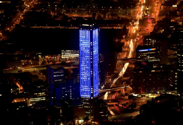 The Colpatria tower is pictured as it is lit up in blue to honor the 70th anniversary of the United Nations in Bogota, Colombia, October 23, 2015. (Photo by Jose Miguel Gomez/Reuters)