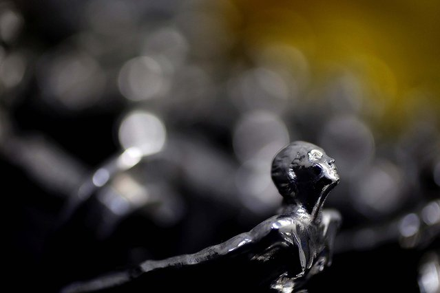 """A finished """"Spirit of Ecstasy"""" is seen at Polycast Limited. (Photo by Stefan Wermuth/Reuters)"""