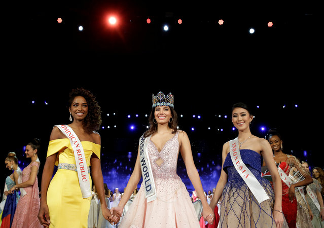 Winner of Miss World Miss Puerto Rico Stephanie Del Valle (C) stands with first runner up Miss Dominican Republic Yaritza Miguelina Reyes Ramirez (L) and second runner up Miss Indonesia Natasha Mannuela during the Miss World 2016 Competition in Oxen Hill, Maryland, U.S., December 18, 2016. (Photo by Joshua Roberts/Reuters)
