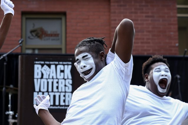 Gospel mime performers dance during a stop on the Freedom Ride For Voting Rights at Ebenezer Baptist Church in Atlanta, Georgia, U.S. June 21, 2021. (Photo by Dustin Chambers/Reuters)