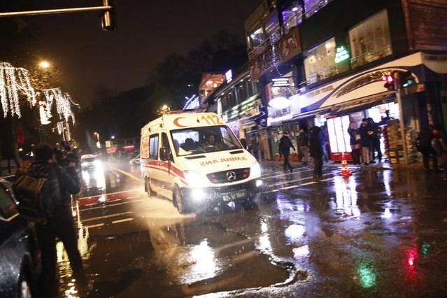 An ambulance rushes from the scene of an attack in Istanbul, early Sunday, January 1, 2017. (Photo by Halit Onur Sandal/AP Photo)