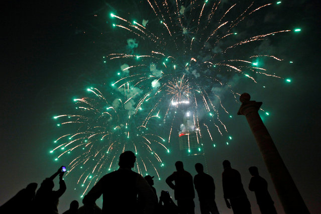 People gather to observe fireworks in celebration of the New Year in Karachi, Pakistan, January 1, 2017. (Photo by Akhtar Soomro/Reuters)