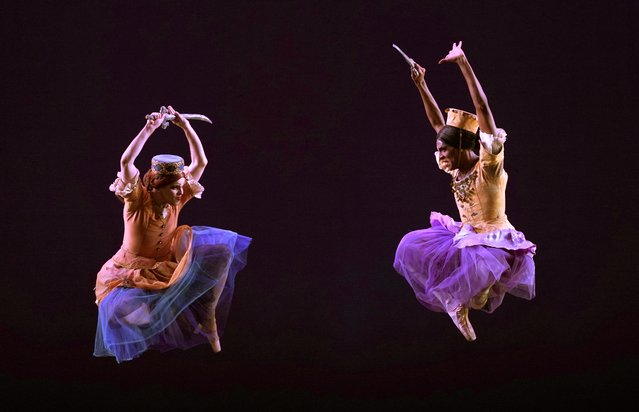 """Dancers from  Les Ballets Trockadero de Monte Carlo perform a scence from """"Trovatiara"""" during a dress rehearsal December 11, 2018 before opening night at the Joyce Theater. Les Ballets Trockadero de Monte Carlo is an all-male drag ballet troupe that parodies the conventions of romantic and classical ballet. (Photo by Timothy A. Clary/AFP Photo)"""