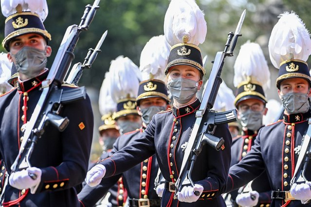 Belgium's Crown Princess Elisabeth, center, marches past the Royal tribune with cadets of the military school during the National Day parade in Brussels, Wednesday, July 21, 2021. (Photo by Laurie Dieffembacq/Pool Photo via AP Photo)