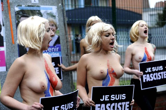 FEMEN activists protest in front the pole station JJ Rousseau school during Front National leader Marine Le Pen vote as part of the second round of the French departementales elections in Henin Beaumont, France on March 29, 2015. (Photo by Sarah Alcalay/SIPA Press)
