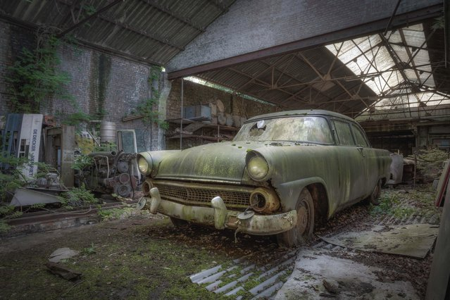 An abandoned car has a green hint to its bodywork after it was left in an old workshop. (Photo by Kenneth Provost/Mediadrumworld.com)