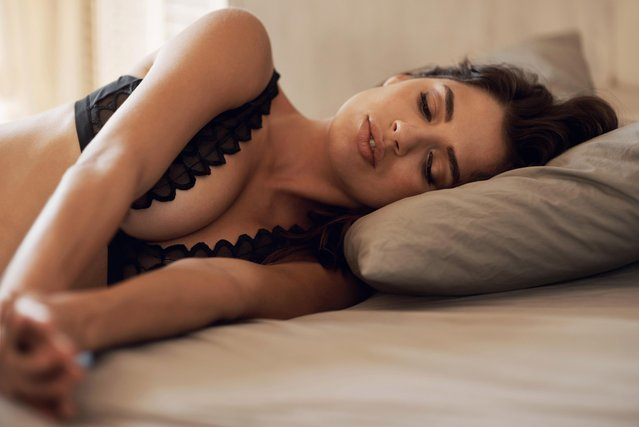 Sleeping delight. Gorgeous brunette asleep on a bed. (Photo by PeopleImages/Getty Images)
