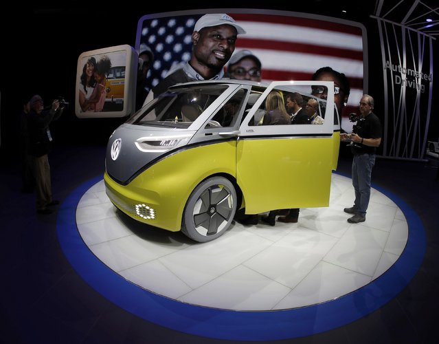 Journalists look over a Volkswagen I.D. Buzz electric concept vehicle during the North American International Auto Show in Detroit, Michigan, U.S., January 10, 2017. (Photo by Mark Blinch/Reuters)