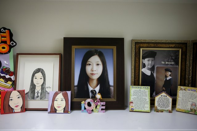 Pictures are seen in a room belonging to Jeon Ha-yeong, a high school student who died in the Sewol ferry disaster, in Ansan April 7, 2015. Her dream was to be an international aid worker. (Photo by Kim Hong-Ji/Reuters)