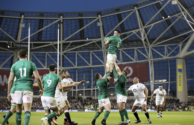 Ireland's James Ryan is held aloft as he takes lineout ball during the Six Nations rugby union international between Ireland and England, in Dublin, Ireland, Saturday, February 2, 2019. (Photo by Peter Morrison/AP Photo)
