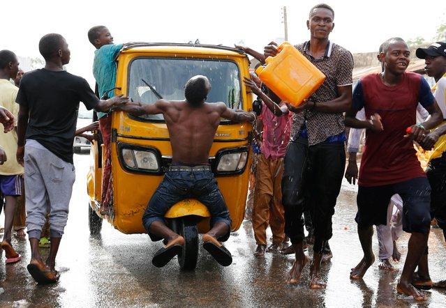 Supporters of President Muhammadu Buhari celebrate in Yola, Adamawa State, Nigeria on February 27, 2019. (Photo by Nyancho NwaNri/Reuters)