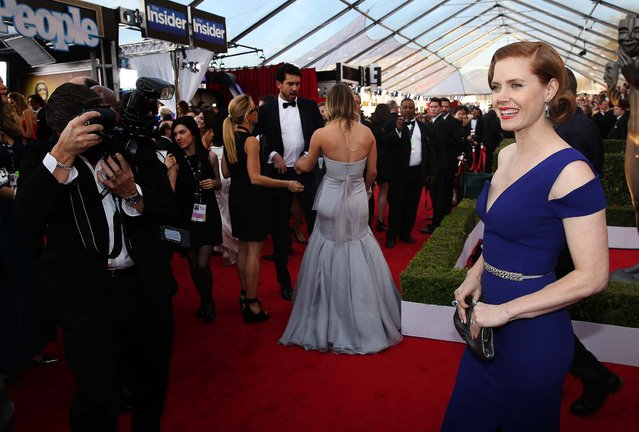 Amy Adams arrives at the 20th annual Screen Actors Guild Awards at the Shrine Auditorium. (Photo by Matt Sayles/AP Photo/Invision)