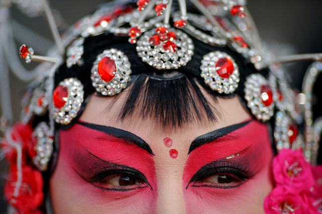 A performer in traditional costume waits for her turn to go on stage at Longtan park as the Chinese Lunar New Year, which welcomes the Year of the Rooster, is celebrated in Beijing, China January 29, 2017. (Photo by Damir Sagolj/Reuters)