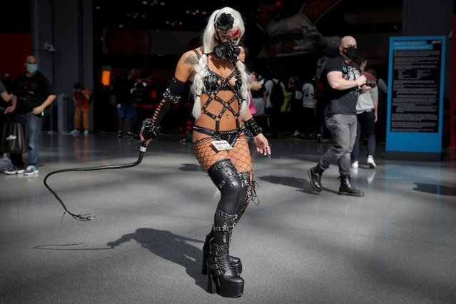 A woman in custume attends the 2021 New York Comic Con, at the Jacob Javits Convention Center in Manhattan in New York City, New York, U.S., October 7, 2021. (Photo by Brendan McDermid/Reuters)
