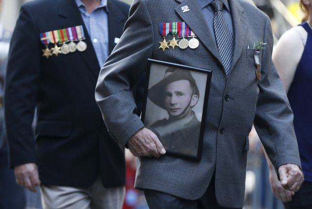 A photograph of a an Australian war veteran is carried along with medals awarded during an ANZAC Day parade marking the 100th anniversary of the formation of the ANZAC alliance in Sydney, Australia, April 25, 2015.  ANZAC, which stands for Australian and New Zealand Army Corps, formed on April 25, 1915 as Australian and New Zealand soldiers formed part of the allied expedition that set out to capture the Gallipoli peninsula in Turkey. (Photo by Jason Reed/Reuters)