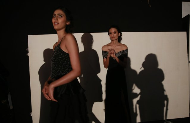 In this February 1, 2017 photo, Anjali Lama, right, a transgender model from Nepal, waits backstage for her turn to walk the ramp during Lakme Fashion week in Mumbai, India. (Photo by Rafiq Maqbool/AP Photo)