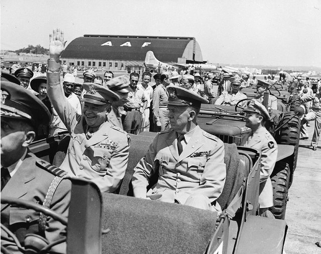 U.S. General Dwight D. Eisenhower (L) sits in the back of a jeep with U.S. Army Chief of Staff General George C. Marshall, as he waves to spectators at the Washington National Airport, in Arlington, Virginia, on June 18 1945, in this handout photo provided by the United States National Archives and Records Administration. (Photo by Reuters/United States National Archives and Records Administration)