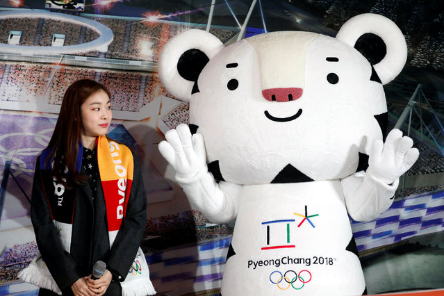"""The PyeongChang Organizing Committee for the 2018 Olympic and Paralympic Winter Games (POCOG) Honorary Ambassador Kim Yuna looks at the Olympic mascot """"Soohorang"""" during the ceremony to mark a year to the 2018 PyeongChang Winter Olympic Games in Gangneung, South Korea February 9, 2017. (Photo by Kim Hong-Ji/Reuters)"""