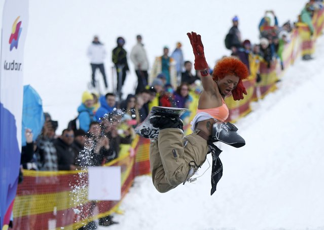A participant jumps during the Red Bull Jump and Freeze competition at the ski resort of Gudauri, Georgia, March 20, 2016. (Photo by David Mdzinarishvili/Reuters)