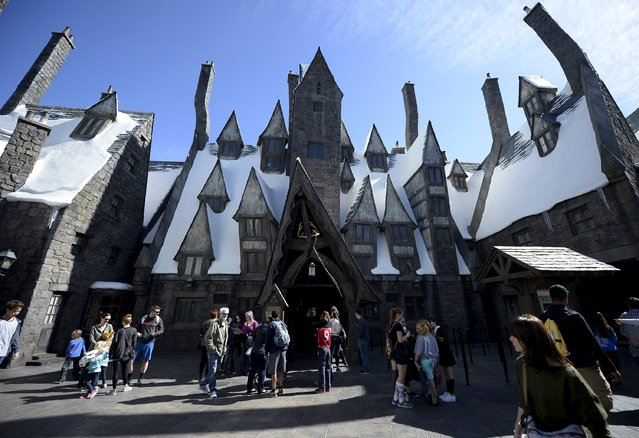 """Guests walk through Hogsmeade Village during a soft opening and media tour of """"""""The Wizarding World of Harry Potter"""" theme park at the Universal Studios Hollywood in Los Angeles, California in this picture taken March 22, 2016. (Photo by Kevork Djansezian/Reuters)"""