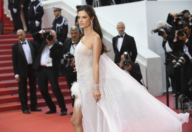 "Model Alessandra Ambrosio poses for photographers upon arrival at the opening ceremony and the premiere of the film ""The Dead Don't Die"" at the 72nd international film festival, Cannes, southern France, Tuesday, May 14, 2019. (Photo by Arthur Mola/Invision/AP Photo)"