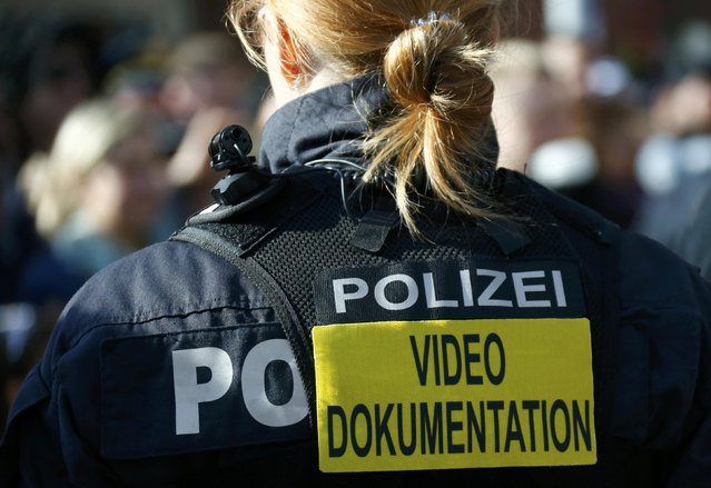 """Police walks with a body cam at the """"Rosenmontag"""", Rose Monday parade in Fulda, Germany, February 27, 2017. (Photo by Ralph Orlowski/Reuters)"""