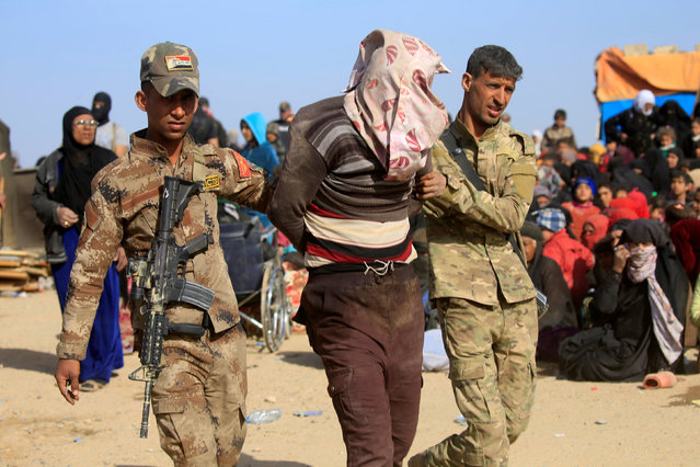 Iraqi Special Operations Forces arrest a person suspected of belonging to Islamic State militants in western Mosul, Iraq February 26, 2017. Picture taken February 26, 2017. (Photo by Alaa Al-Marjani/Reuters)