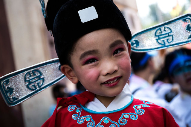 A child parades on a float during the Bun Festival on May 25, 2015 in Hong Kong, Hong Kong. One of Hong Kong's most colourful cultural celebration event, Cheung Chau Bun Festival, will be staged on 25 May 2015 (Monday) till 26 May 2015 midnight (Tuesday). This festival has over 100 years of history. (Photo by Lam Yik Fei/Getty Images)