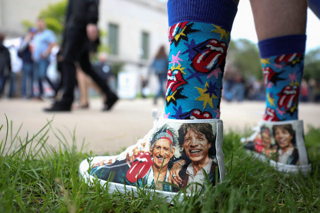 "Mick Jagger and Keith Richards are seen on the shoes of Andrew Weaseman, a fan who traveled from Nashville, Tennessee for the show, ahead of the kick-off show of the Rolling Stones' ""No Filter"" tour at Soldier Field in Chicago, Illinois, U.S. June 21, 2019. (Photo by Daniel Acker/Reuters)"