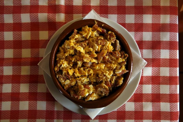 "A dish of ""Duelos y quebrantos"" (griefs and breakings), which Cervantes wrote was Don Quixote's Saturday meal, is pictured at a restaurant in Puerto Lapice, Spain, April 8, 2016. The main ingredients are scrambled eggs, chorizo, ham, bacon and sometimes lamb brains. (Photo by Susana Vera/Reuters)"