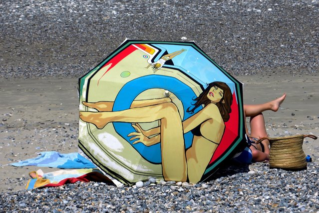A woman sunbathes on the beach, as the heatwave hits France, in Le Hourdel, near Cayeux-sur-Mer, France, June 29, 2019. (Photo by Pascal Rossignol/Reuters)