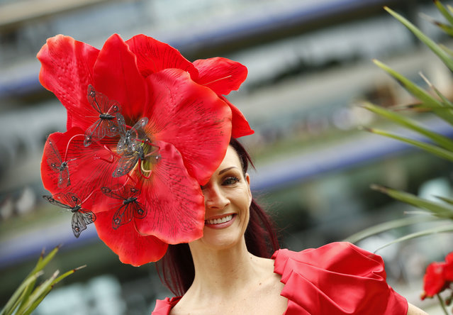 Chelsey Baker smiles as she poses for photographers on the second day of  Royal Ascot horse racing meet at Ascot, England, Wednesday, June 17, 2015. Royal Ascot is the annual five day horse race meeting that Britain's Queen Elizabeth II attends every day of the event.(AP Photo/Alastair Grant)