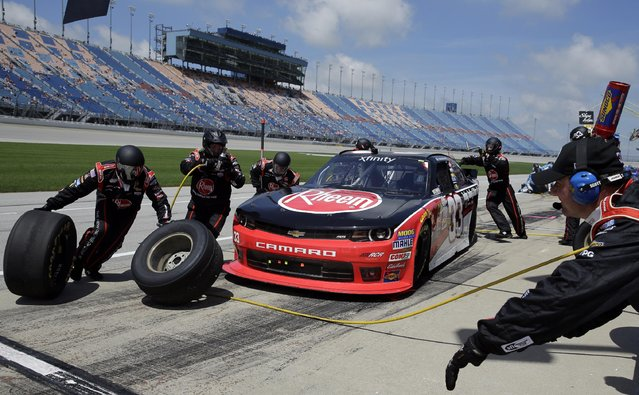 Austin Dillon (33) makes a pit stop during the NASCAR Xfinity series auto race at Chicagoland Speedway, Sunday, June 21, 2015, in Joliet, Ill. (AP Photo/Nam Y. Huh)