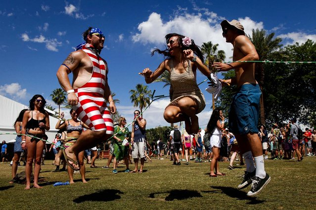 A group of friends jump rope at the Coachella Music and Arts Festival. (Photo by Bethany Mollenkof/Los Angeles Times/MCT)