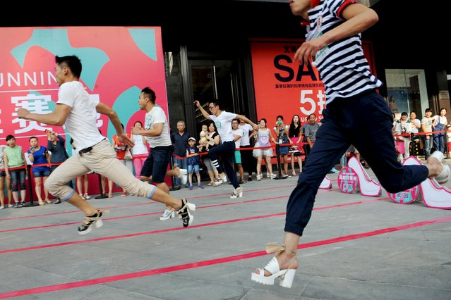 Men ran as they take part in a high-heels race in Taiyuan, Shanxi province, China, July 3, 2015. The winning man won a 1,000 yuan ($161) coupon after the 50 meter race, according to local media. (Photo by Reuters/Stringer)