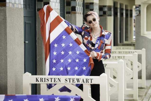 Kristen Stewart poses for the photographers after she unveiled her cabin sign as a tribute for her career along the Promenade des Planches during the 45th Deauville American Film Festival on September 13, 2019 in Deauville, France. (Photo by Francois Durand/Getty Images)