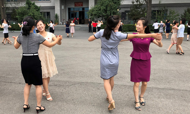 Women dancing after voting in a local assembly election in Pyongyang, North Korea on July 21, 2019. (Photo by Yevgeny Agoshkov/TASS)