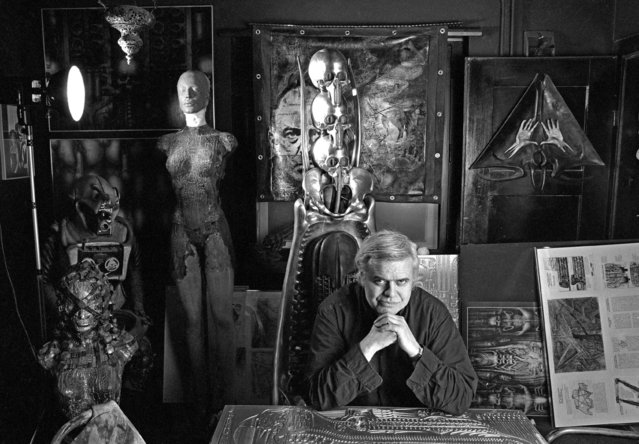 "A black and white file photo dated 29 January 1995 shows Swiss artist H. R. Giger in his home in Zurich, Switzerland. Giger died on 12 May 2014 aged 74, according to Swiss media. He was a surrealist painter, sculptor, and set designer, and was part of the special effects team that won an Academy Award for Best Achievement for Visual Effects for their design work on the film ""Alien"". (Photo by Martin Ruetschi/EPA)"