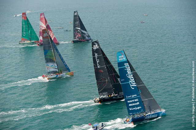 The fleet of Volvo Open 70's power away from the line, at the start of leg 4 of the Volvo Ocean Race 2011-12 on February 19, 2012