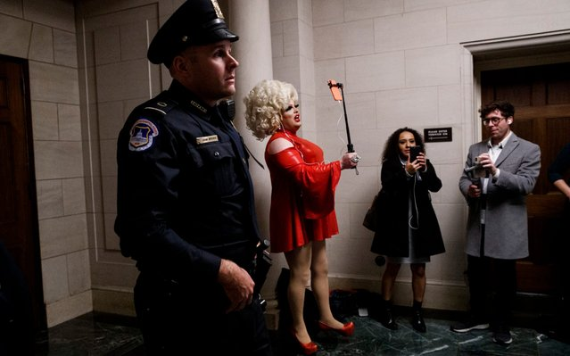 Pissi Myles, center, a special contributor with Happs News, a live news source that streams through Twitter, reports with her cell phone, Wednesday, November 13, 2019, on Capitol Hill in Washington, during the first public impeachment hearings of President Donald Trump's efforts to tie U.S. aid for Ukraine to investigations of his political opponents. (Photo by Jacquelyn Martin/AP Photo)