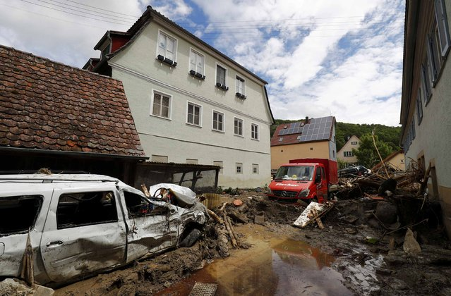 Damaged cars are pictured after floods in the town of Braunsbach, Germany, May 30, 2016. (Photo by Kai Pfaffenbach/Reuters)