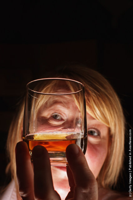 Julie Cameron tour guide holds a glass of whisky at Edradour distillery on March 26, 2012 in Pitlochry, United Kingdom