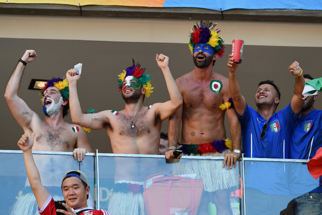 Italy fans dressed up as indians cheer during the 2014 FIFA World Cup Brazil Group D match between England and Italy at Arena Amazonia on June 14, 2014 in Manaus, Brazil. (Photo by Claudio Villa/Getty Images)