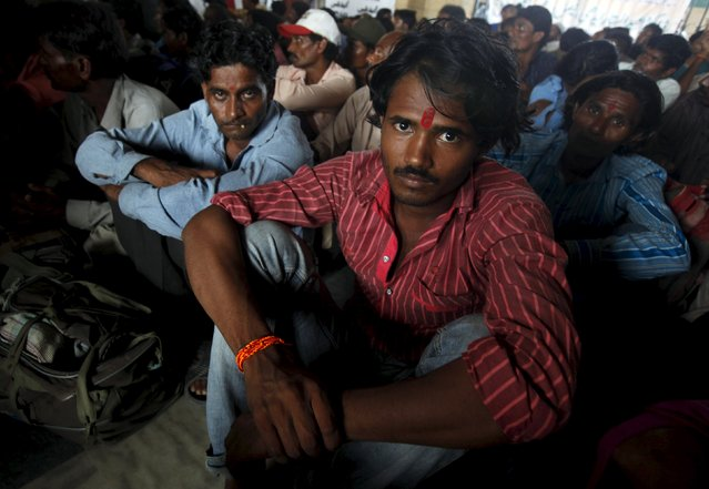 Indian fishermen, released from prison, wait for their train home at Karachi's Cantonment railway station August 2, 2015. According to local media, Pakistani authorities released 163 Indian fishermen who were detained for illegally venturing into Pakistani waters, as a goodwill gesture on Sunday. (Photo by Akhtar Soomro/Reuters)
