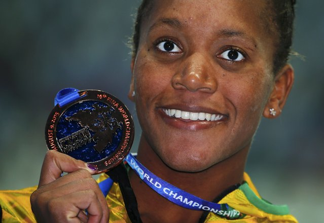 Third placed Alia Atkinson of Jamaica pose with her bronze medal after the women's 100m breaststroke final at the Aquatics World Championships in Kazan, Russia, August 4, 2015. (Photo by Hannibal Hanschke/Reuters)