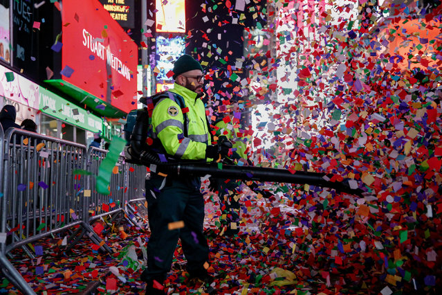 A New York City Department of Sanitation worker cleans the streets after the New Year celebrations in Times Square in the Manhattan borough of New York City, U.S., January 1, 2020. (Photo by Amr Alfiky/Reuters)