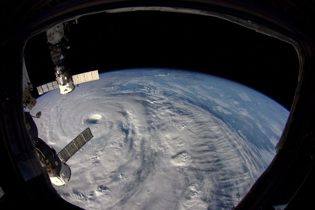 This handout photo released by European Space Agency (ESA) on July 8, 2014 and taken by ESA astronaut Alexander Gerst of Germany shows typhoon Neoguri as seen from the International Space Station ISS. Typhoon Neoguri lashed Japan's southern Okinawa islands Tuesday, reportedly leaving two dead and forcing more than half a million to seek shelter as the region's worst storm in years damaged buildings, downed trees and brought air and sea traffic to a halt. (Photo by Alexander Gerst/AFP Photo/NASA/ESA)