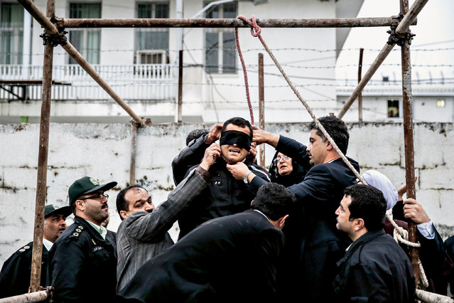 Geste de Pardon / Forgiveness Gesture series, 2014. In Iran, hangings generally take place in public. The family of a murder victim can participate in the execution by pushing the guilty person's chair away. In 2014, a young man called Balal was deemed responsible for stabbing Abdollah Hosseinzadeh to death in a street fight. Instead of pushing the chair, Hosseinzadeh's mother slapped Balal. This is a symbolic gesture of forgiveness and, in accordance with tradition, ended the execution. (Photo by Arash Khamooshi/The Guardian)
