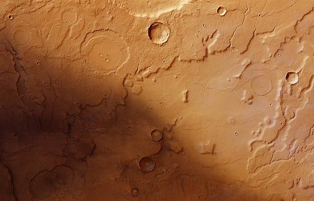 An image from the European Space Agency's Mars Express orbiter, released on May 4, 2012 shows channels cut into the terrain of Acidalia Planitia and Tempe Terra on the Red Planet